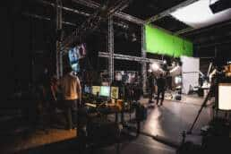 Virtual Production Filming with LED Screens and Green Screens Computers